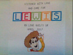 Cross stitch square for Lewis T's quilt