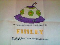 Cross stitch square for Finley M's quilt